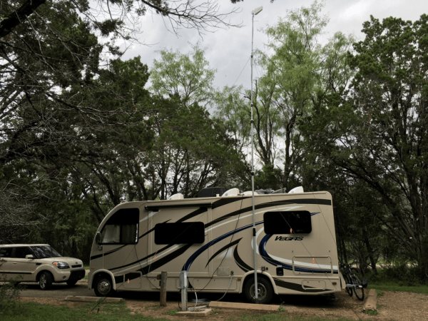 Heavy Duty mast used with a Drive on Mount at a RV park camp site to increase their WiFi reception range extension