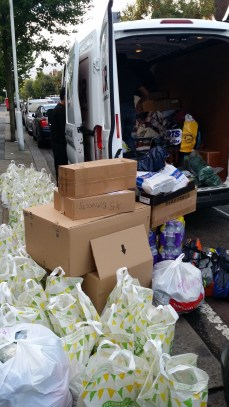 Loading up thousands of pounds worth of food and aid supplies.