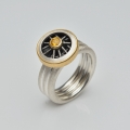 silver and 22ct gold with yellow sapphire (£840)