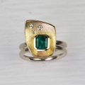 18ct white and yellow with emerald and diamonds (£2750)