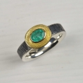 silver, partly oxidised and 18ct with emerald (£475)