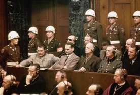 "Defendants at Nuremberg Trials: The Nuremberg Trials were a series of trials held in Nuremberg, Germany in 1945–46 where former Nazi leaders were tried as war criminals by the International Military Tribunal. The indictment filed against them contained four counts: crimes against peace, crimes against humanity, war crimes and "" a common plan or conspiracy to commit"" the criminal acts listed in the first three counts. (Photo Credit: Corbis)"
