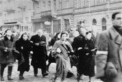 Jews from the Warsaw ghetto are marched through the ghetto during deportation. Warsaw, Poland, 1942-1943. — Instytut Pamieci Narodowej