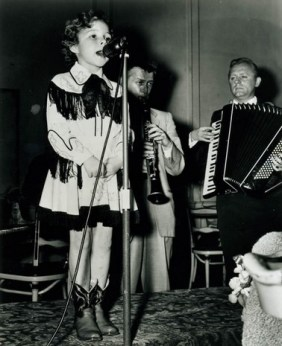 Brenda Lee singing on stage as a child
