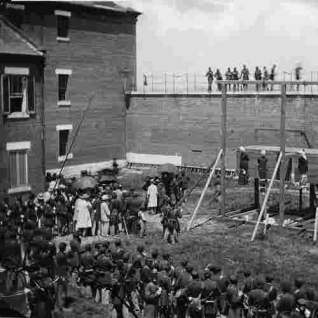 Official photograph of the hanging of Mary Surratt, Lewis Payne, David Herold and Georg Atzerodt on July 7, 1865, convicted of conspiracy in the assassination of President Lincoln.