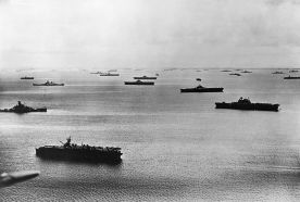 The U.S. fleet at Majuro Atoll in 1944. Visible (among many other ships) are three Independence-class light carriers, four Essex-class carriers, USS Enterprise (CV-6, right front), a South Dakota-class battleship, and two Iowa-class battleships.