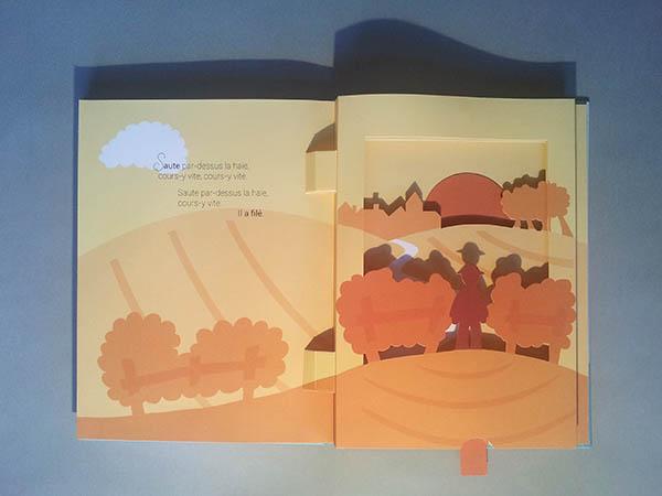 Livre pop-up Le bonheur est dans le pré, page 7 avec diorama et tirette pour le coucher du soleil