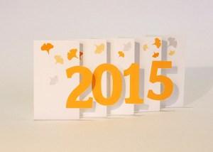 Carte de voeux 2015 MHT Pop up, papier découpé en accordéon, modèle Ginkgos oranges