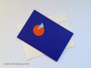 Carte pop-up Spirale motifs abstraits, bleu-violet-orange, repliée avec enveloppe. Pièce unique signée