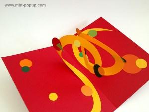 Carte pop-up Spirale motifs abstraits, rouge-jaune, détail de la spirale. Pièce unique signée