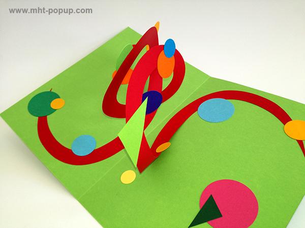 Carte pop-up Spirale motifs abstraits, vert-rouge, détail de la spirale. Pièce unique signée