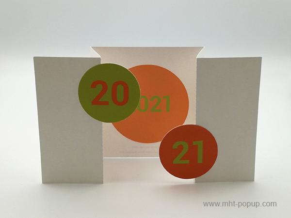Carte de vœux à volets 2021, orange-vert, vue carte ouverte de face avec motif central orangé