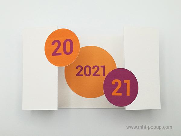 Carte de vœux à volets 2021, version violine-orange, vue dessus carte ouverte avec motif central orangé