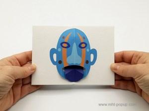 Livre d'artiste accordéon Masques pop-up, tire-la-langue, bleu, d'inspiration océanienne
