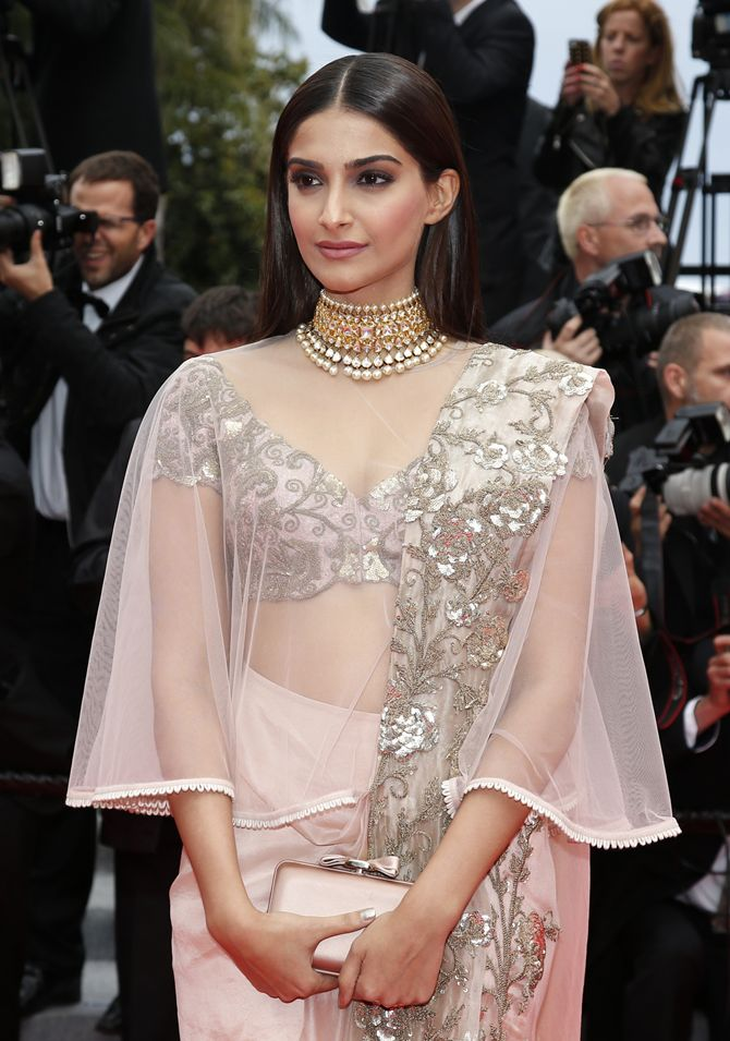 "Indian actress Sonam Kapoor poses on the red carpet as she arrives for the screening of the film ""Foxcatcher"" in competition at the 67th Cannes Film Festival in Cannes"