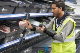 Medium-movers are picked using RF technology and an intelligent conveyor system