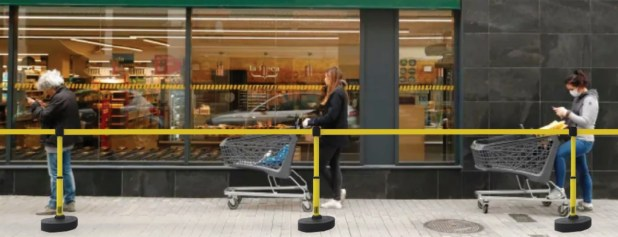 Supermarket  queuing with barrier