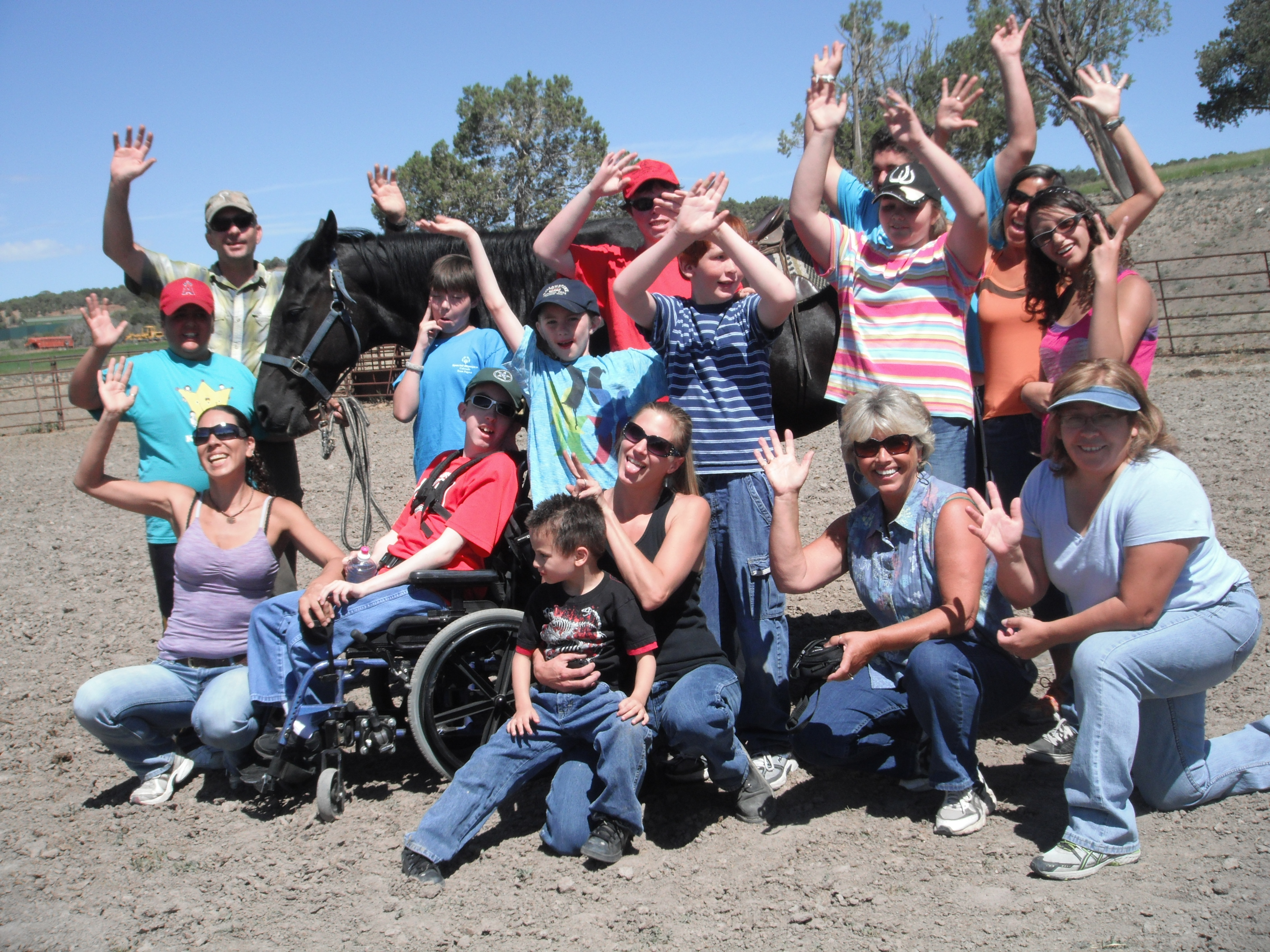 Special needs group excited after day of riding horses.
