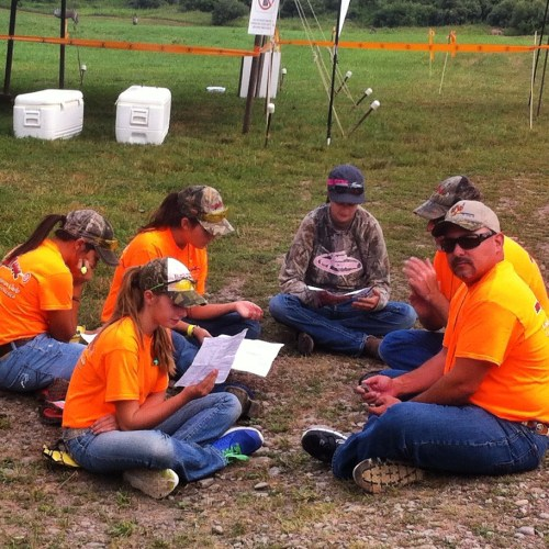 LG and her new New Mexico friends study their hunting licenses for the Hunter Safety trail course.