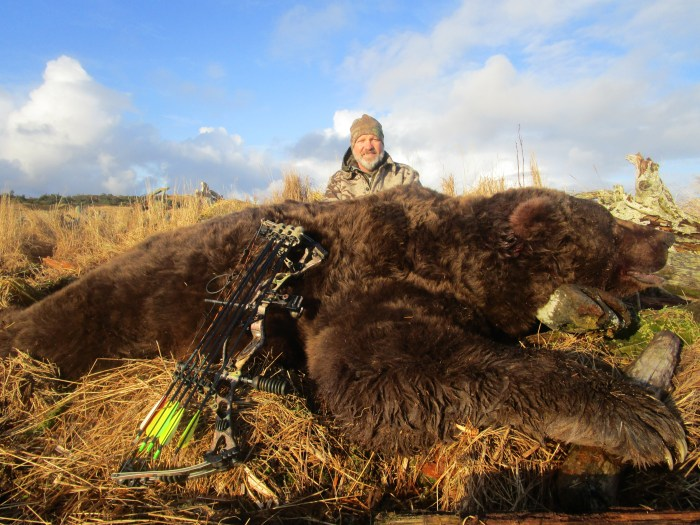 Jim Wellims with his Alaskan brown bear.