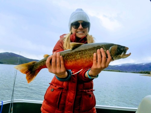 Dr. Lindsay Regali of Virginia with her record breaking arctic char, recently caught in Dillon Reservoir