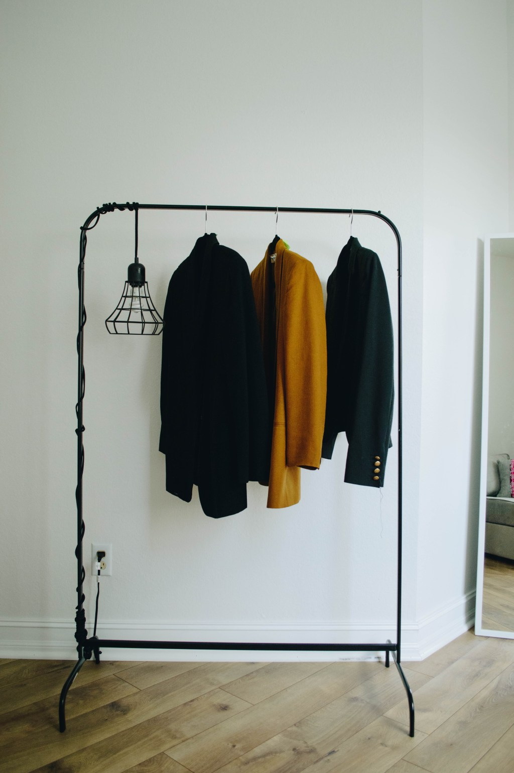 garment rack and hanging lght pendant
