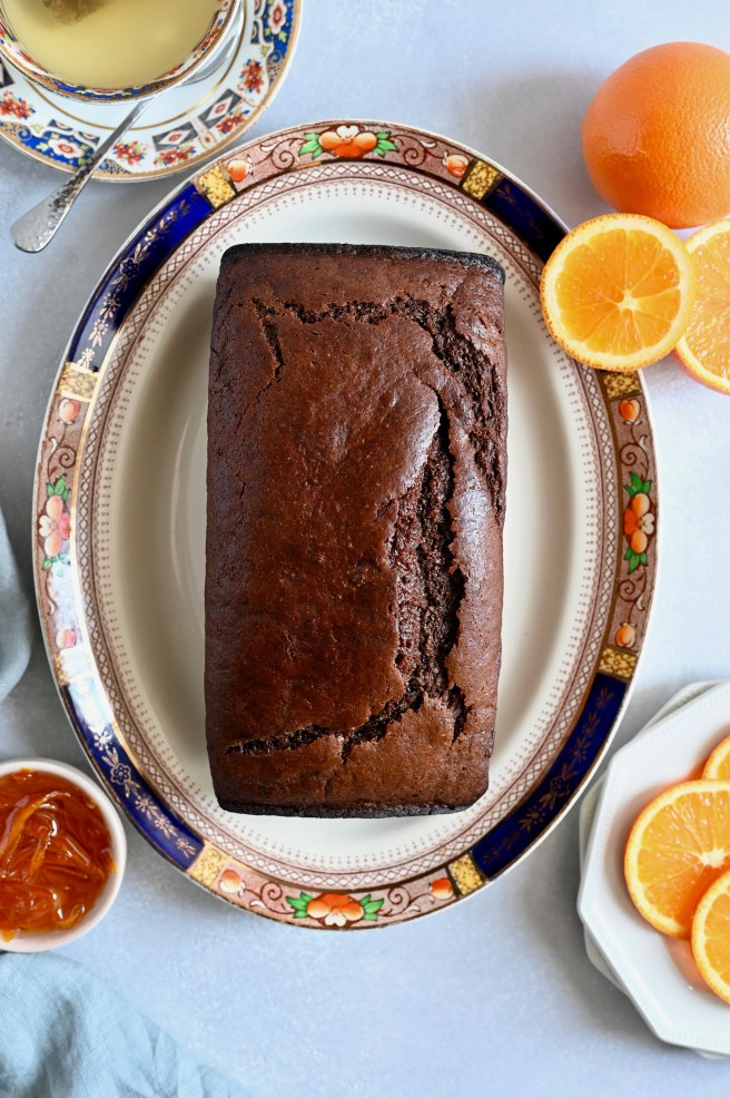 A vegan chocolate and orange cake served with an orange glaze