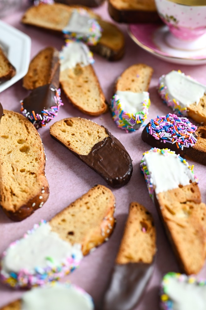 Greek biscotti, or paximadia, made with tsoureki bread and dipped in chocolate and sprinkles