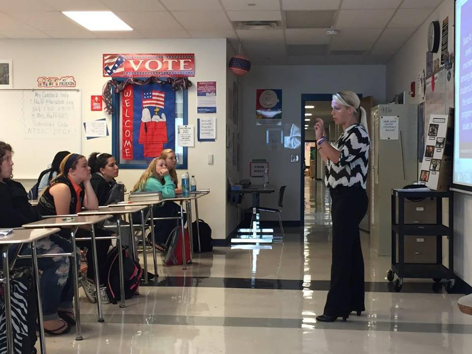 Halle speaking at Hamilton High in Mrs. Huff's class about getting involved with Seat at the Table and how important it is to get involved in your community.