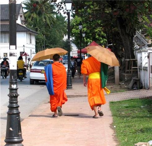 Monks with umbrellas, Luang Prabang, Laos