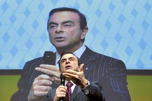 ghosn-with-overhead-screen-gesture-getty-afp-580