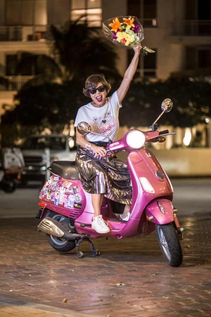 Chuky in a Pink Vespa