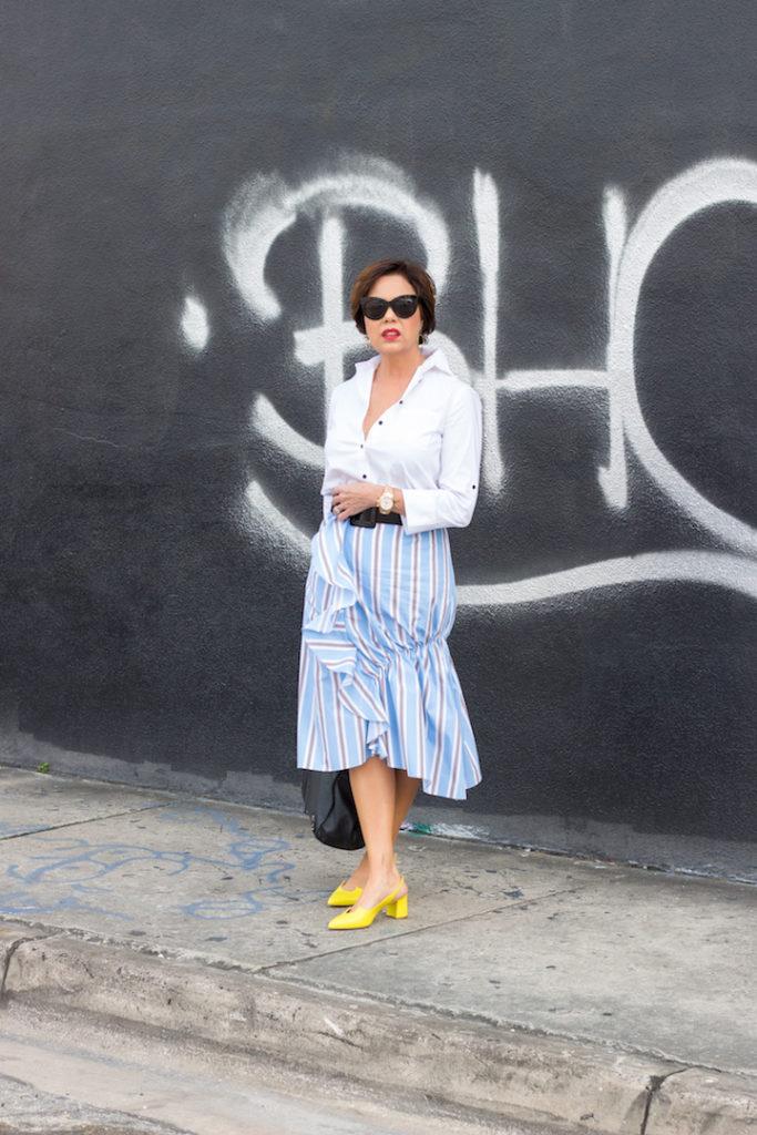 white blouse striped ruffled skirt yellow pumps