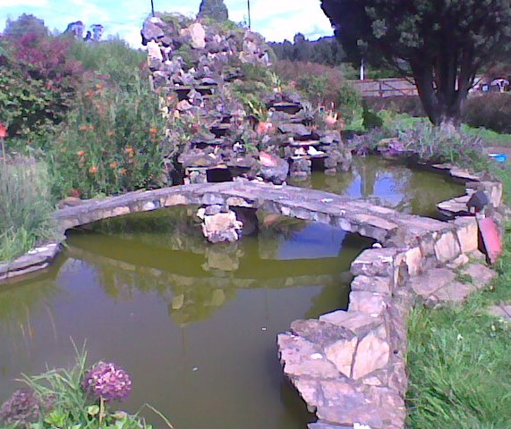 Large stone fountain and pond