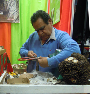 Artisan working making something from a seed is very similar to ivory