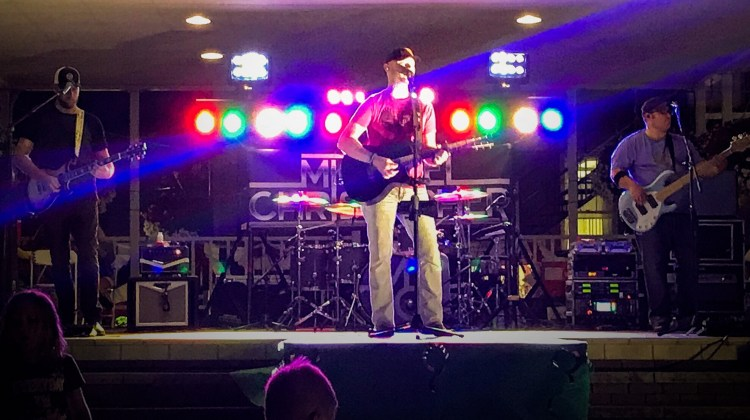 Michael Christopher on stage in pavillion