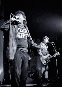 "John Hyatt on lead vocals, with Phillip ""John"" Brennan assisting and on bass"