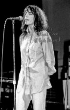 "The Patti Smith Group Memorial Auditorium Louisville, Kentucky 4-26-78 *** The Patti Smith Group; Memorial Auditorium; Louisville; Kentucky; 4-26-78; Any further use requires permission from the photographer; Michael Conen. *** These photos were taken on print film, and then digitally scanned at 2000 dpi. All images viewed here are ""proofs"" of the negatives. Serious inquiries regarding further publication will be entertained. Please contact me with comments, questions, etc. at michaelconen@myway.com"