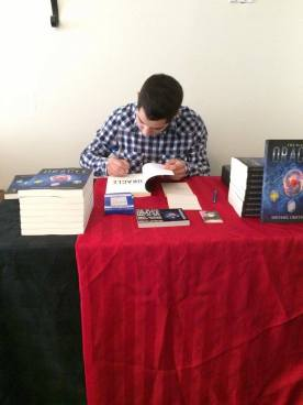 Signing the first copy of The Black Oracle.