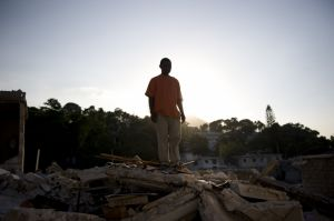 Man stands on the remains of his home