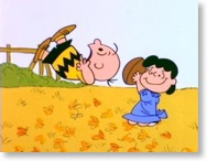 Lucy zieht Charlie Brown den Football weg