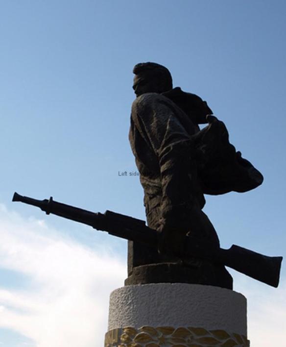 Mujo Ulqinaku with machine gun