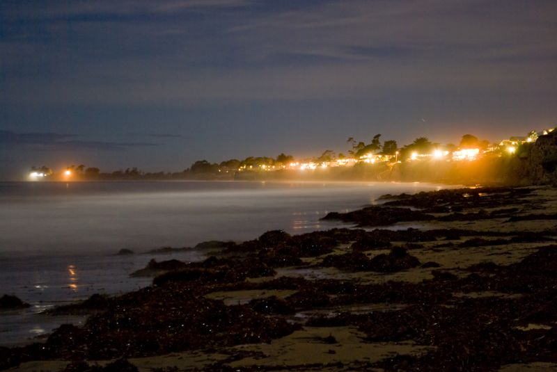 Isla Vista beach at night at high tide, note the kelp.