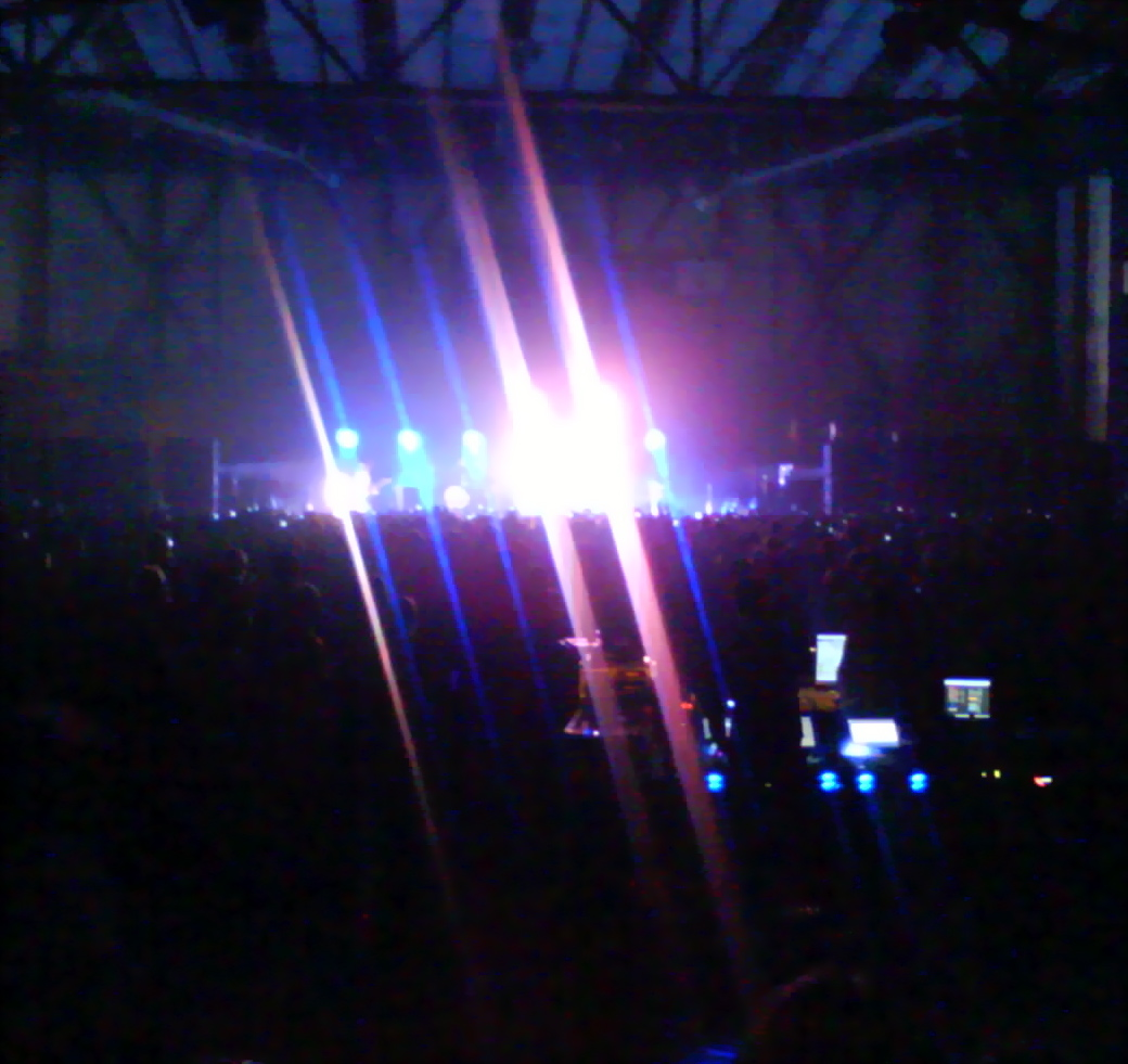 Not a great photo but you can see the rows of cell phones beneath the stage