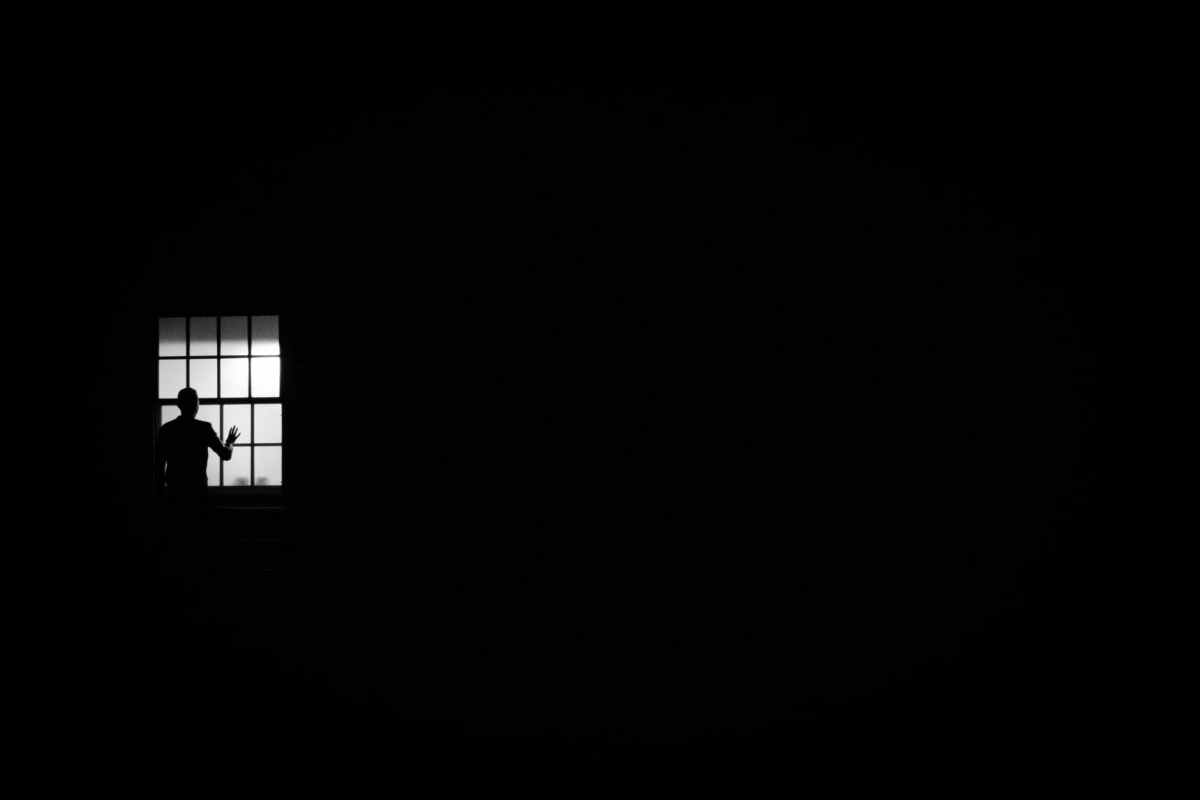 person looking out the window