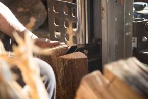 Wood DocumentaryRichard Kinard splits wood before selling it at his wood shed.