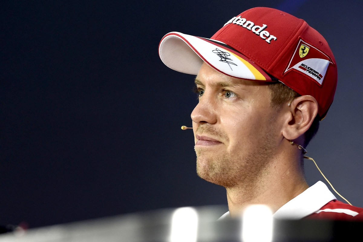 Sebastian Vettel sits in the drivers press conference at the Malaysian Grand Prix.