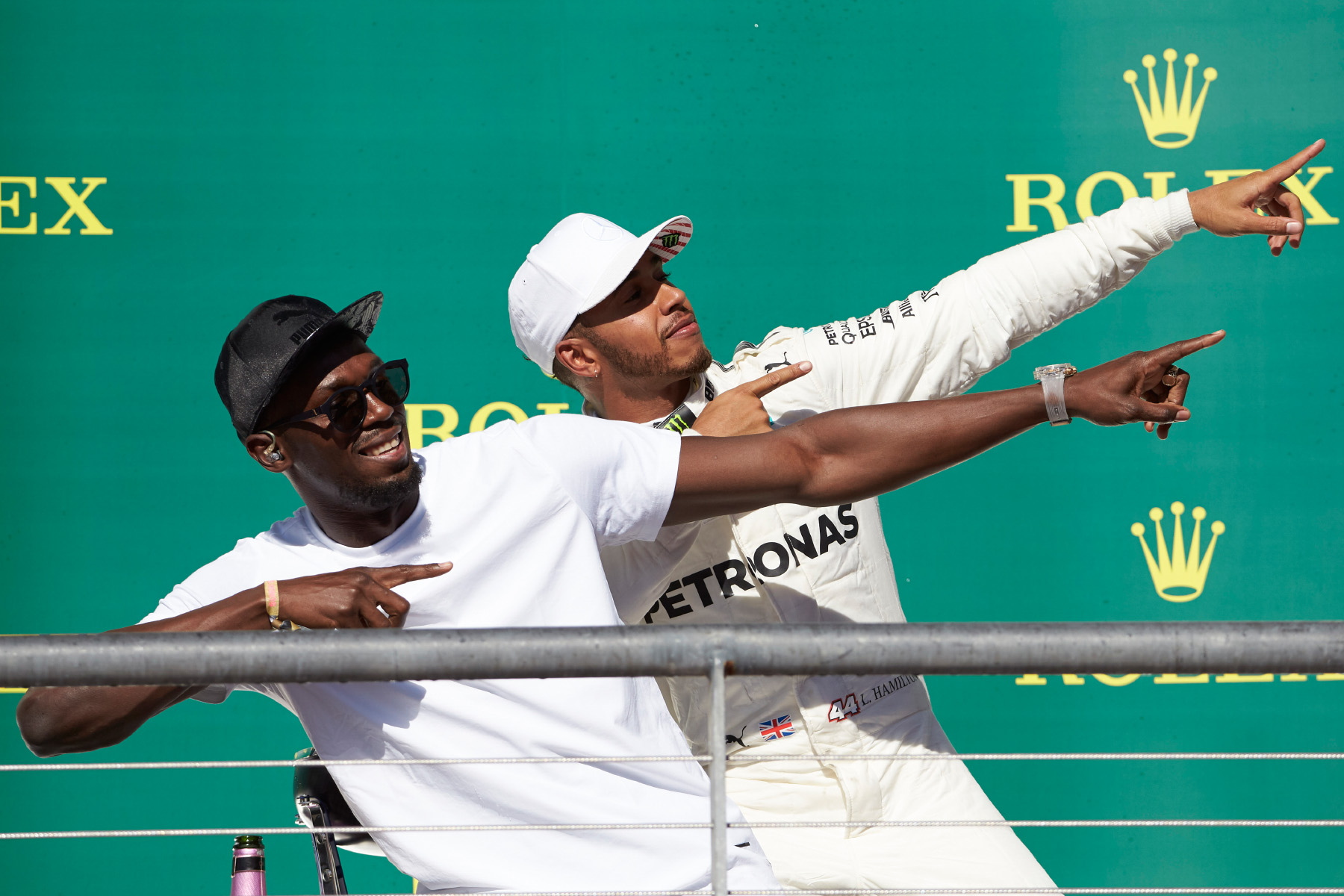 Lewis Hamilton celebrates with Usain Bolt on the 2017 United States Grand Prix podium.