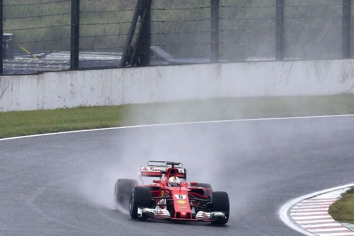 Sebastian Vettel takes to the wet track during FP2 at the 2017 Japanese Grand Prix.