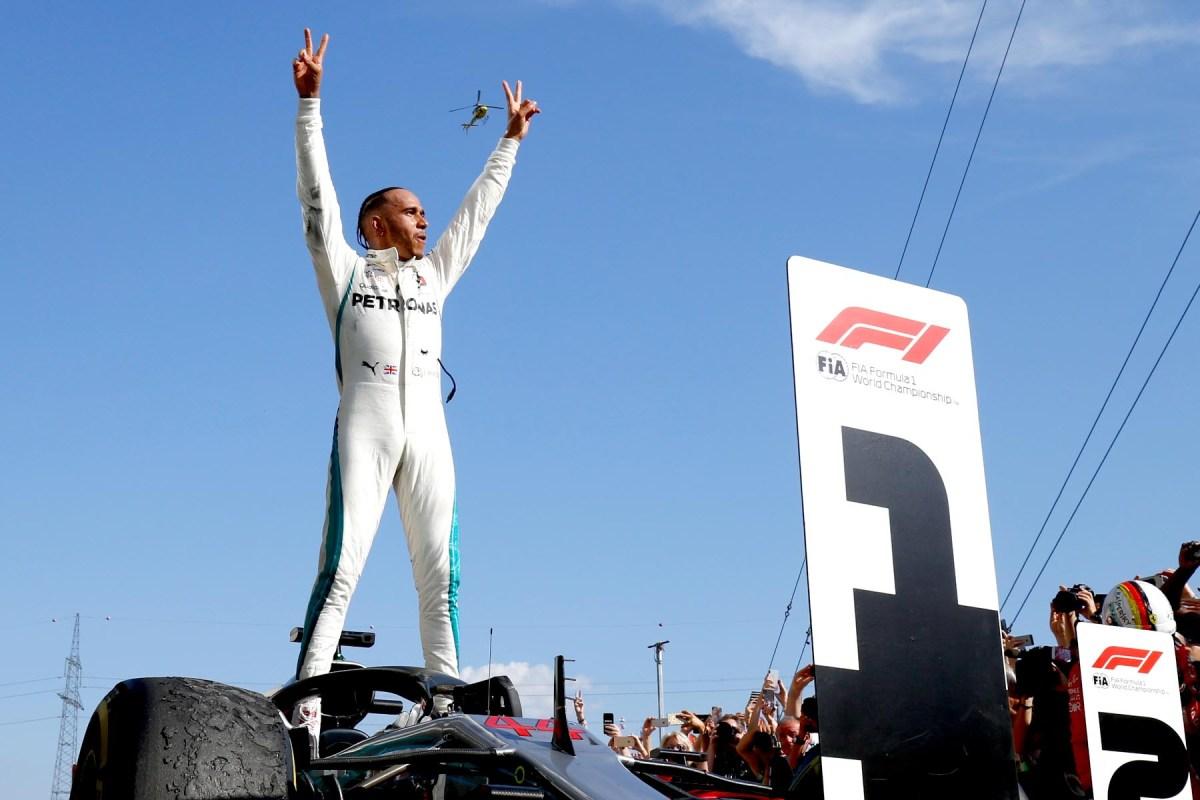 Lewis Hamilton celebrates victory at the 2018 Hungarian Grand Prix.